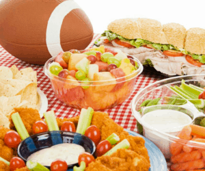 Food laid out on a table for a Super Bowl party